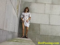 Cute peeing doll enjoying her nice piss onto streets