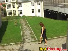 Dissolute flasher bitch pees inside the open air