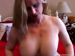 Mature blonde with big...