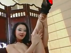 Petite asian teases and masturbates in a garter belt and fishnet