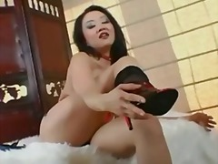 Petite asian teases an...