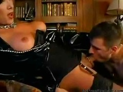 Mature Tgirl in latex coat gets banged