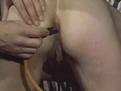 Two Guys Give Girl Enema