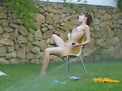Ivana chick getting wet on the grass