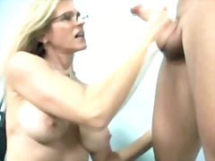 Mature blonde is jacking off cock