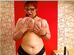 Nuvid - Fat redhead on her webcam shows her big boobs and rubs her pussy