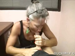 Lusty mature giving handjob on knees