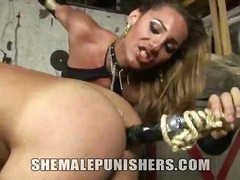 Latex Clad Slave Abused In The Dungeon