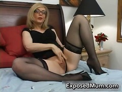 Blond mum in glasses l...