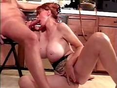 Redhead mature with incredible tits s...