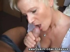 AMATEUR MILF SUCKS AND...