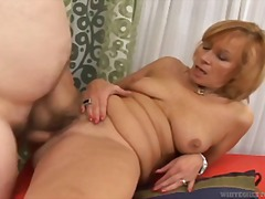 Over Thumbs Movie:Redhead Milf strips and sucks ...