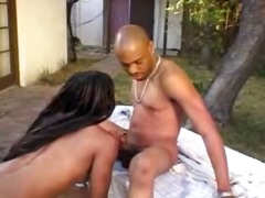Sweet busty ebony MILF eats his black stick outdoors and gets banged
