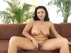 Dark haired mature lady Grace with