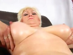 Blond granny Janka in black lingerie