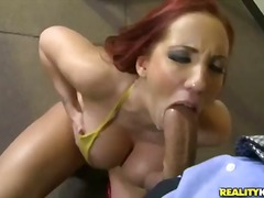 Hot red-haired busty w...