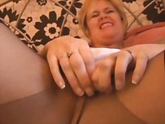 Busty mature babe in p...