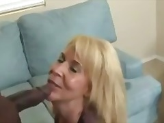 Horny mature sucks on a huge black cock