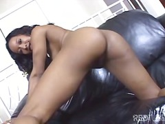 Ebony masturbating wit...