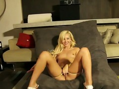 Blonde Aaliyah Love plays with her