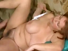 Sexy older woman givin...