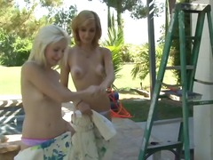Stunning tanned blonde and redhead le...