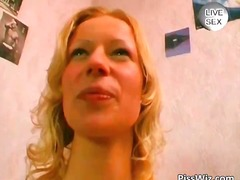 Blonde MILF pisses in ...