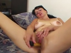 Sixty year old Gina plays with toy