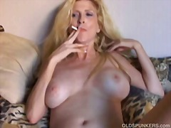 Beautiful blonde MILF enjoys a smoke ...