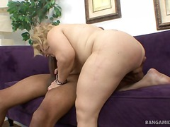 Midget stella gives a two hand blowjob