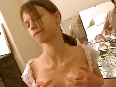 Busty girl fingering snatch home alone