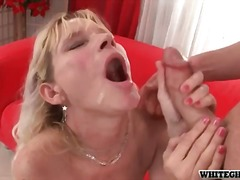 Mature blonde with nice big tits suck...