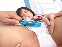 Japanese teen in school uniform plays with her tight pink pussy