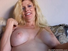 Beautiful blonde mature enjoys a smok...