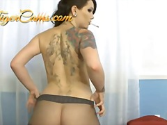 Tattoed babe in pantyh... preview