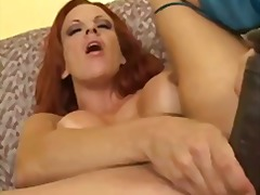 Busty redhead fills he...