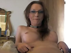 Collared and spectacled tgirl strokes her big dick to a climax