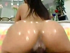Oiled ass bitch loves black hard cocks