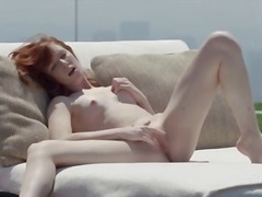Stunning redhead opening vagina outside