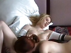 Busty redhead licks le... video