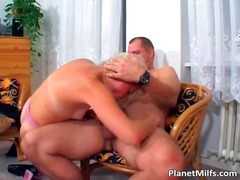 Old blonde slut rides cock on the chair