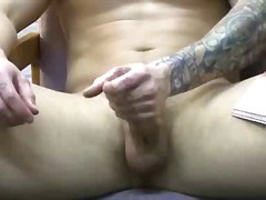 A hot tattooed college stud is jerkin...