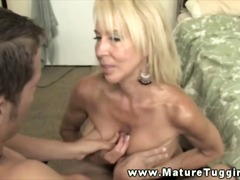 Big titted mature milf giving handjob...