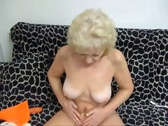 Granny strips nude and plays with her...