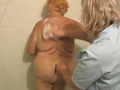 Nurse washes down old ...