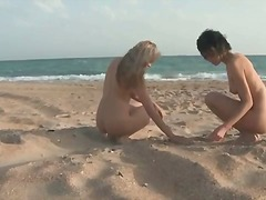 Teens feed each other and walk the beach