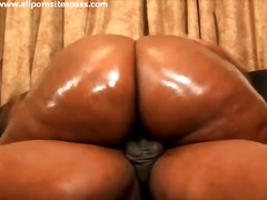Oiled up body on a cock taking black chick