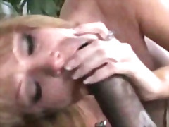 Mom rides a black pole