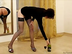 Slim milf likes inserting bottle into...
