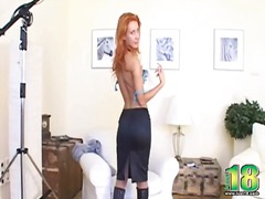 Redhead strips to boots and stockings
